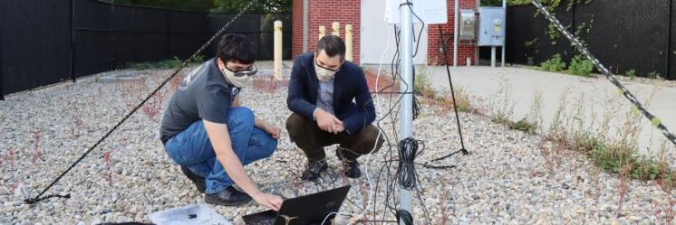 Luis Maldonado and Jason Ostanek check weather sensor data at a cellular transmitter adjacent to ventilation shafts connected to Citizens Energy Group's DigIndy Tunnel System in Indianapolis, Indiana.