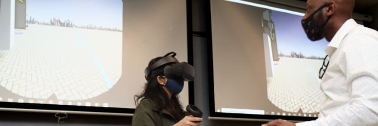 """Ramyani Sengupta and Anthony Sparkling use virtual reality technology in a Knoy Hall laboratory to """"walk"""" through Purdue's future Engineering & Polytechnic Gateway Complex."""