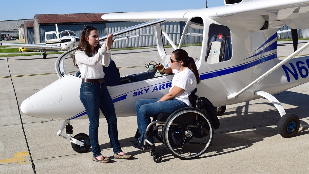 Purdue instructor Molly Van Scoy talks flight details with Able Flight student Melissa Allensworth prior to take-off.