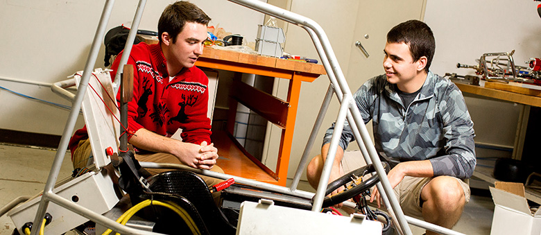 Ben Weiss and Connor McBride work on an electric go-kart for a student project.