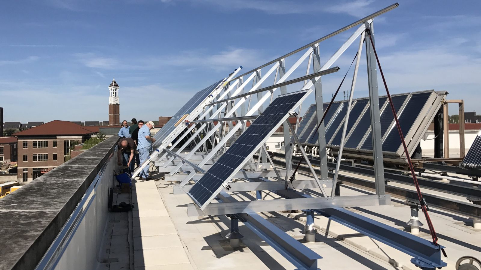 Purdue Polytechnic students and University electricians install new solar panels on Knoy's rooftop