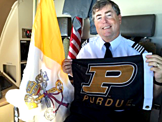 Tom Murray represents Purdue on the papal flight.