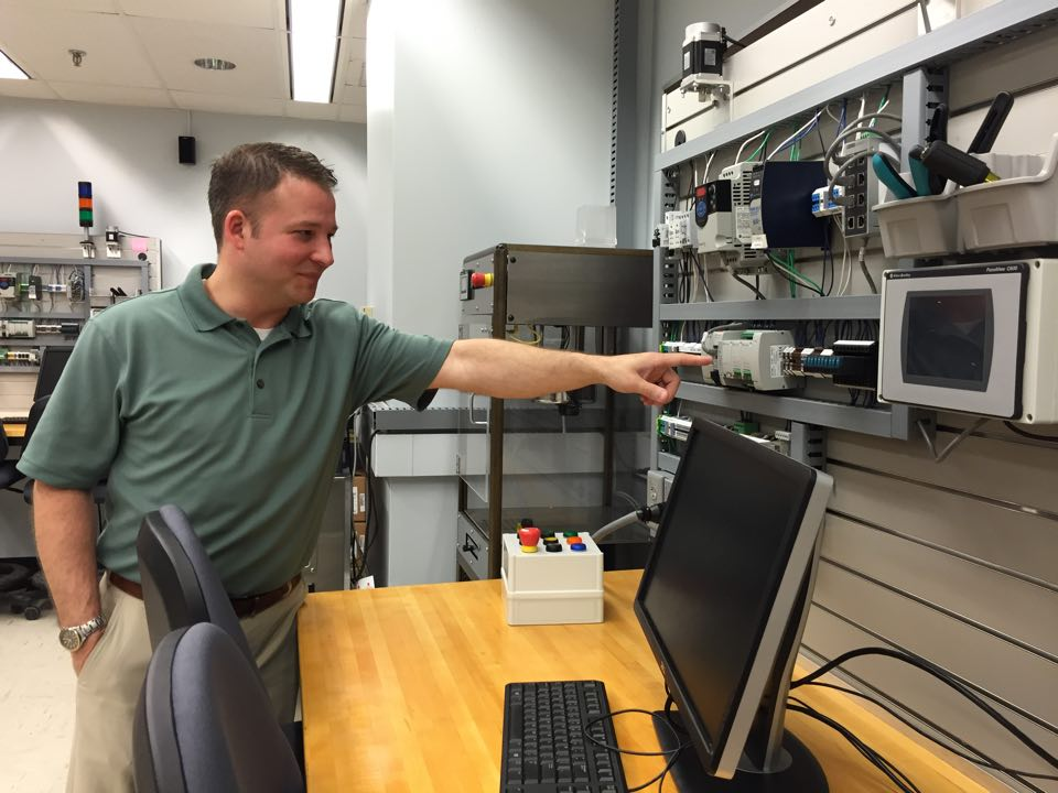 Grant Richards in the industrial controls lab, Knoy 102