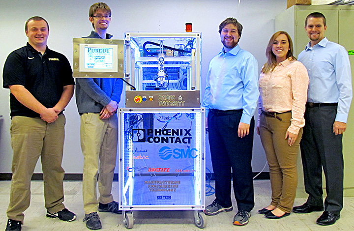 Brandon Bender, Zach Eastman, Brandon Cox, Kaci Kelsey and Ryan Lewis show off their 2015 Xplore Automation entry.