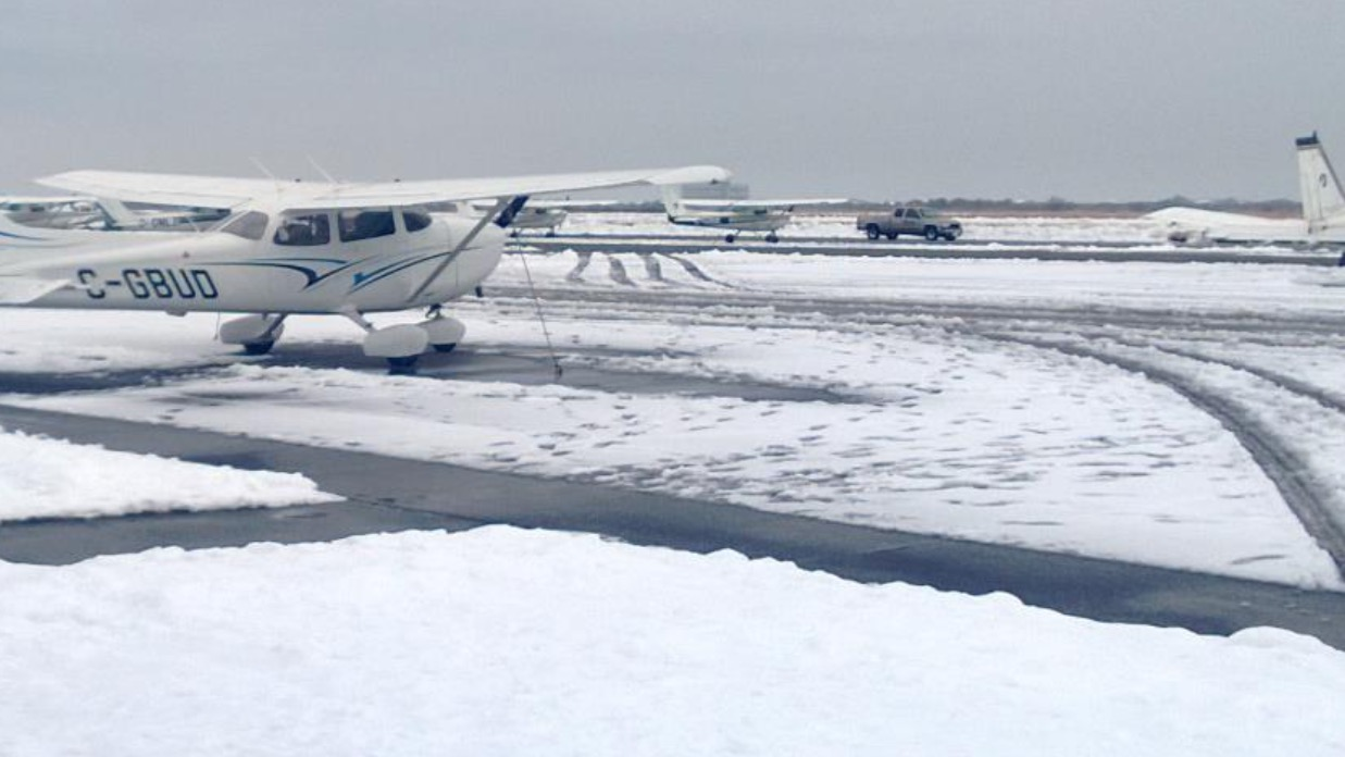 A student research team proposed adapting remote sensing technologies to measure snow and ice on airport runways