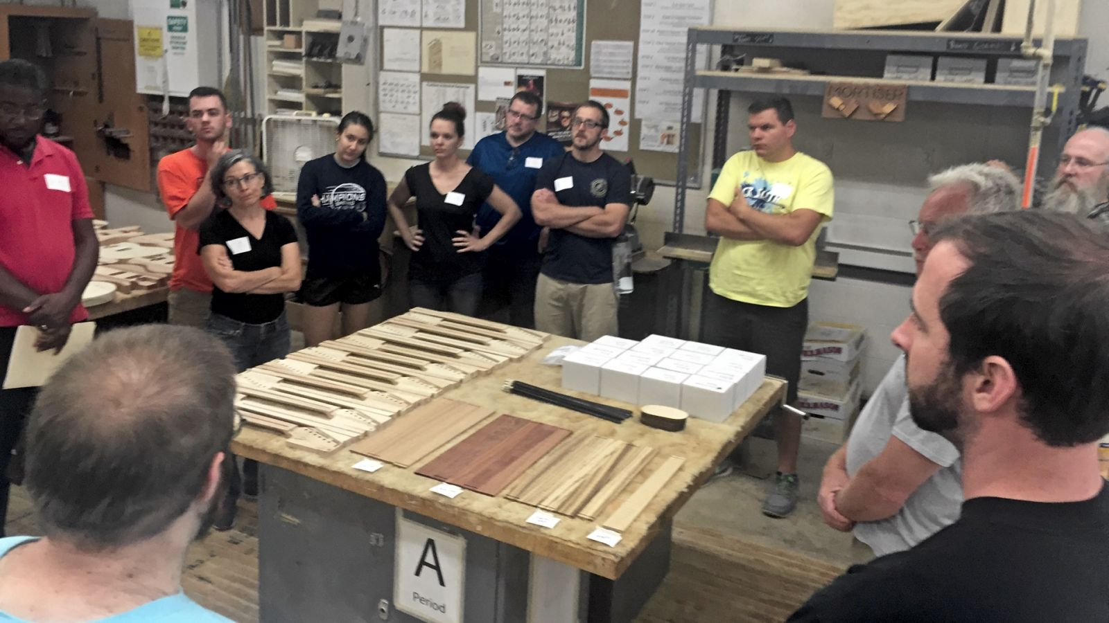 Pennsbury High School teachers receive directions as they prepare to build electric guitars