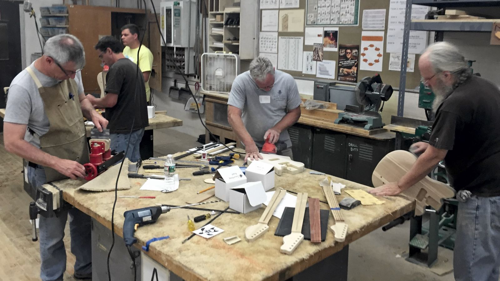Mark French, manufacturing electric guitars with teachers in Fairless Hills, Pennsylvania