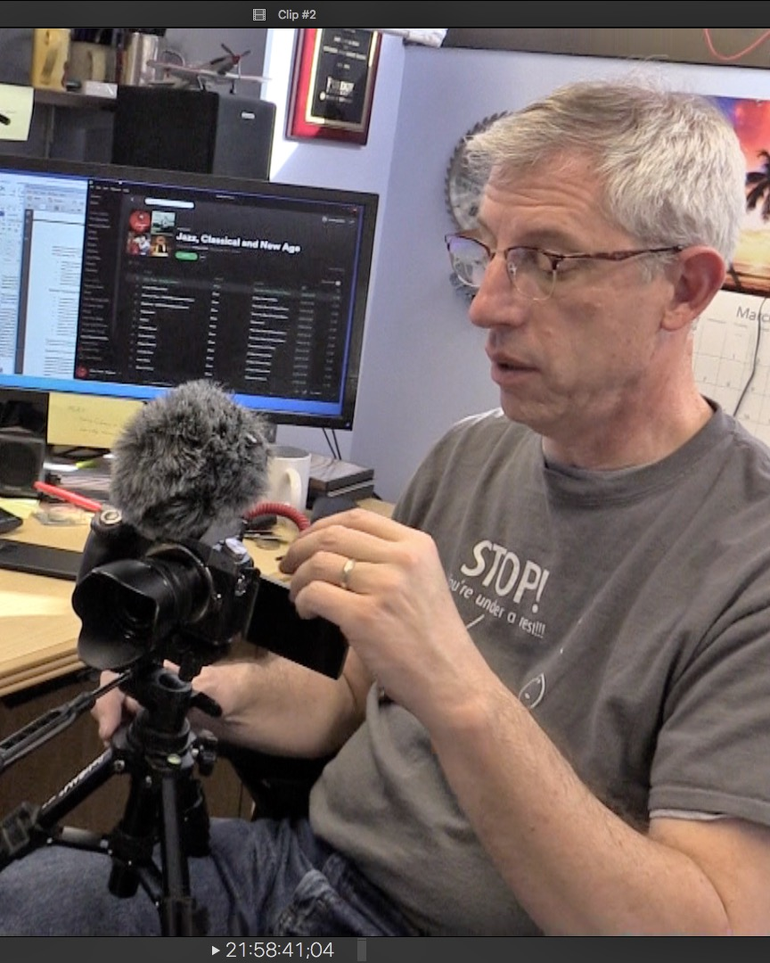 Mark French prepares his camera for a video recording session