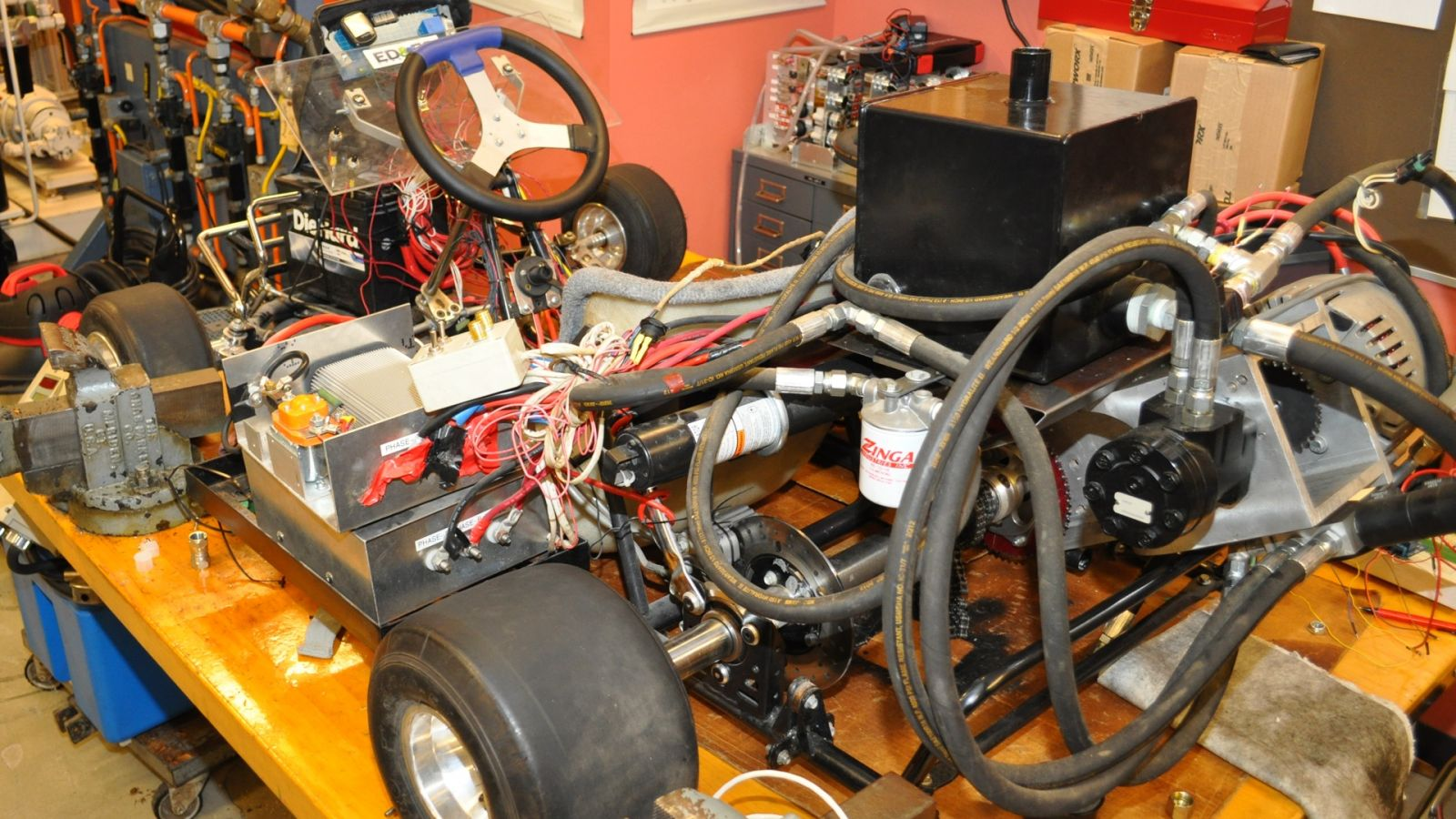 The hydraulic transmission in the go-kart is similar to that in an electric bus