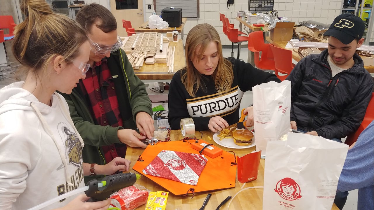 Students in Purdue AMET prepare a Wendy's Baconator & French fry payload for launch