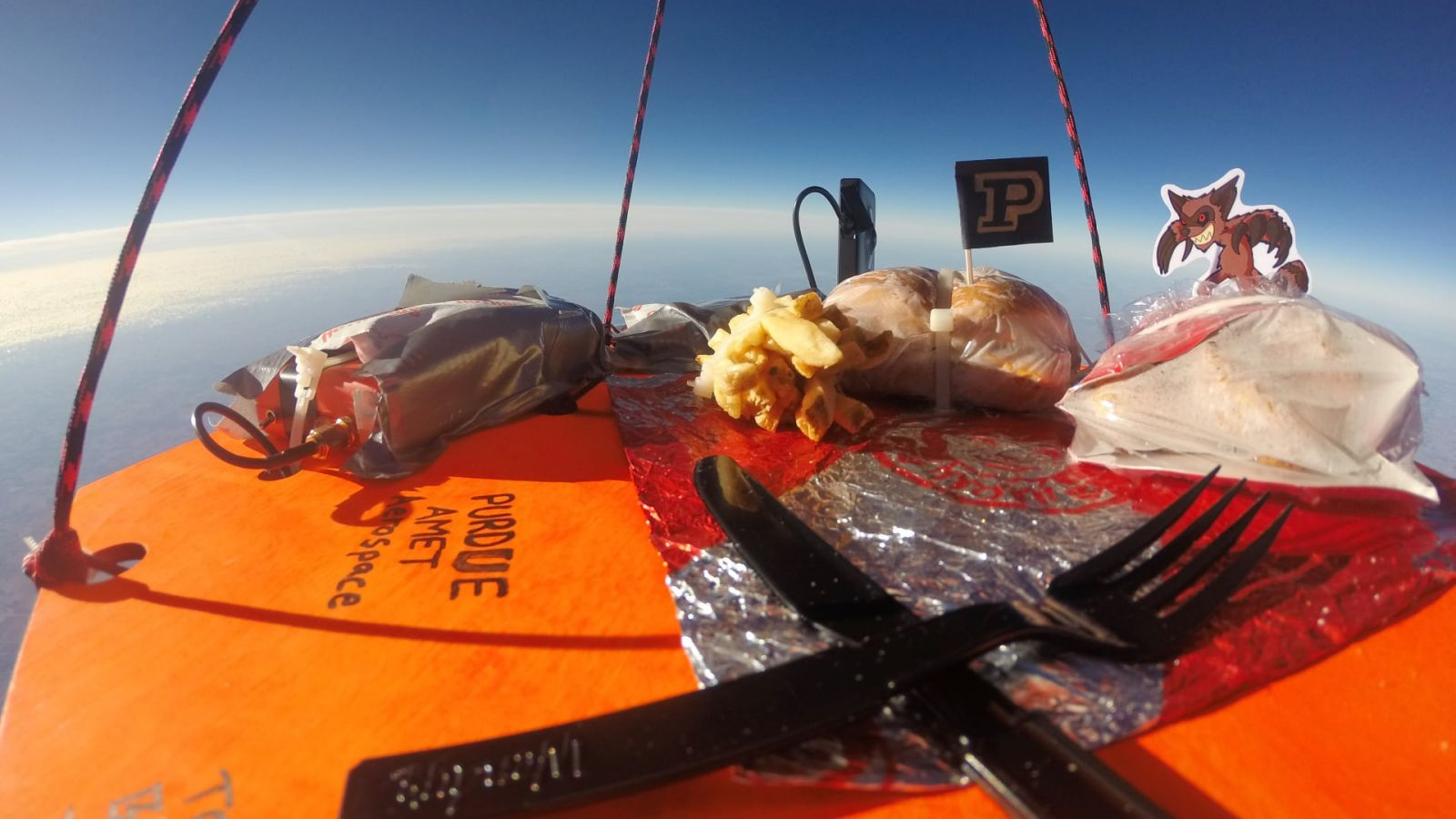 Students in Purdue AMET (Association for Mechanical and Electrical Technologists) lofted a high-altitude weather balloon with a Wendy's Baconator and French fries to 95,000 feet. This photo is from 60,000 feet.
