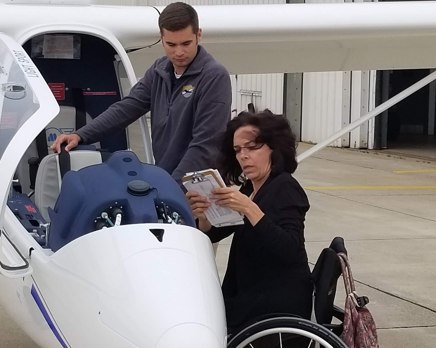 Able Flight student Emily Hupe of California goes through her pre-flight checklist last year at Purdue University Airport. (Purdue University photo/Brian Huchel)