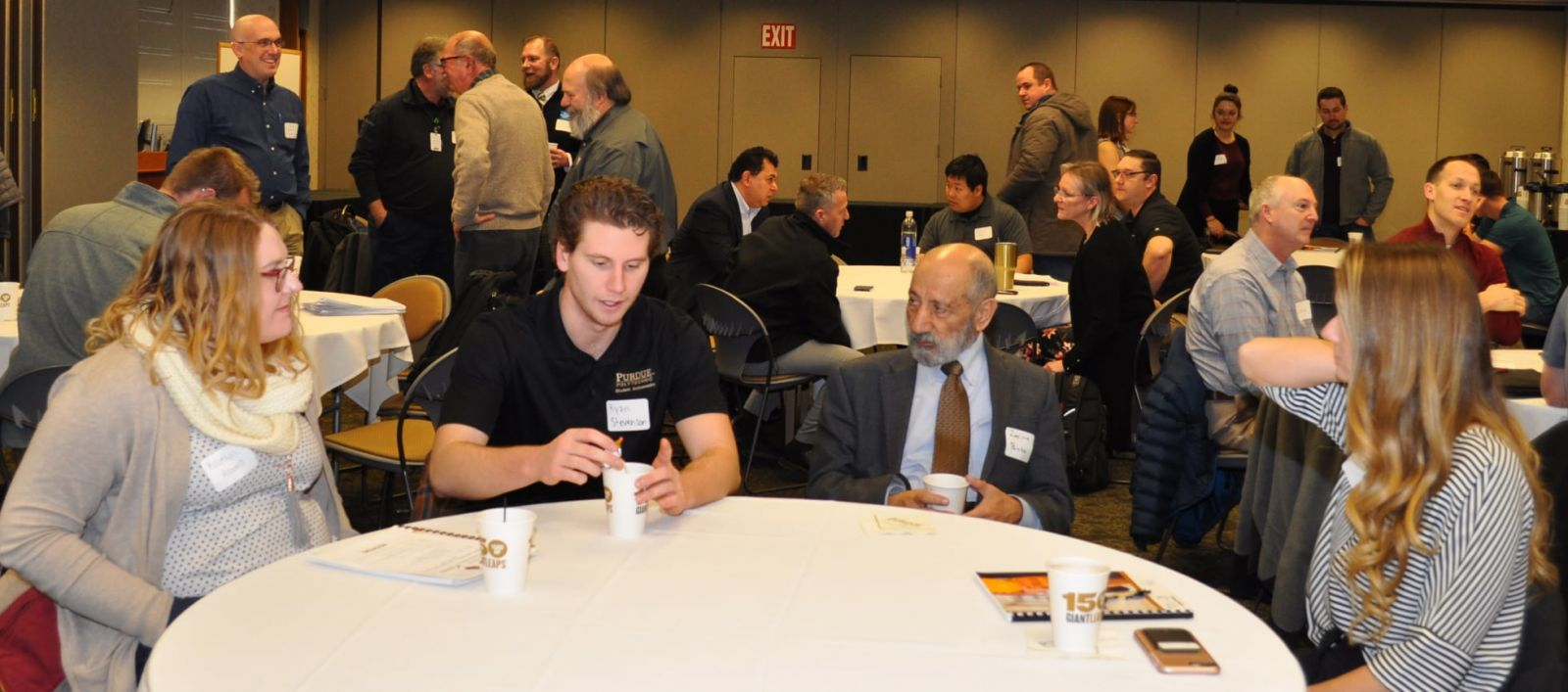Students, faculty and industry representatives networking at the ISHE/ASHE conference