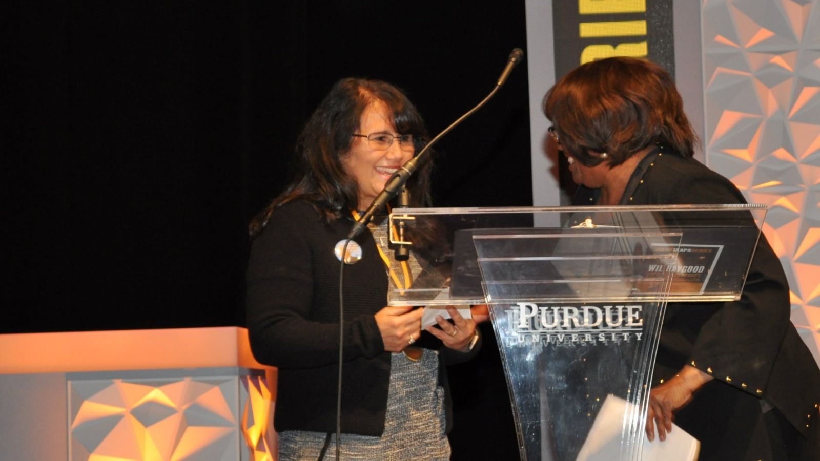 Carolyn Johnson, right, congratulates Toni Munguia on receiving the 2019 Dreamer Award