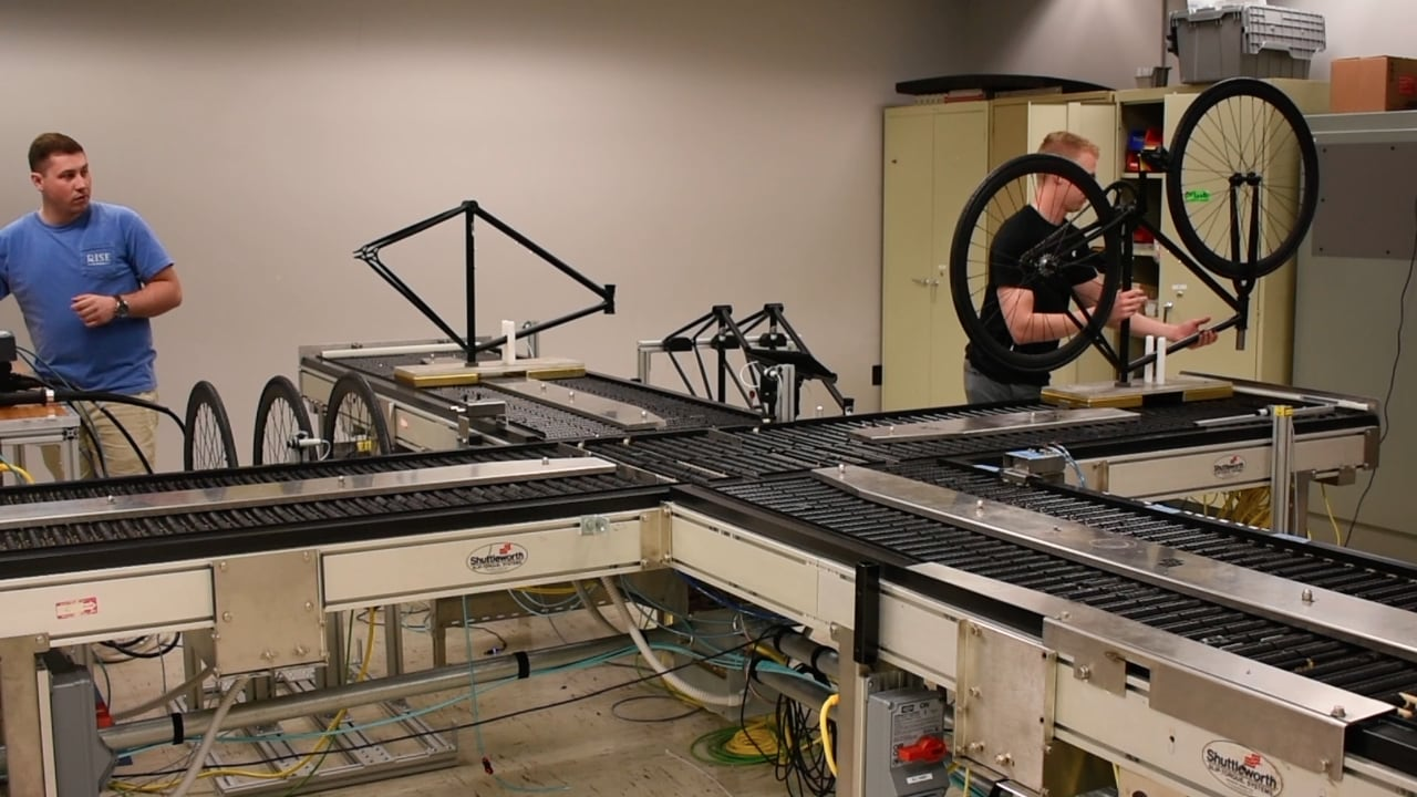 Students work on a prototype of a bicycle manufacturing line