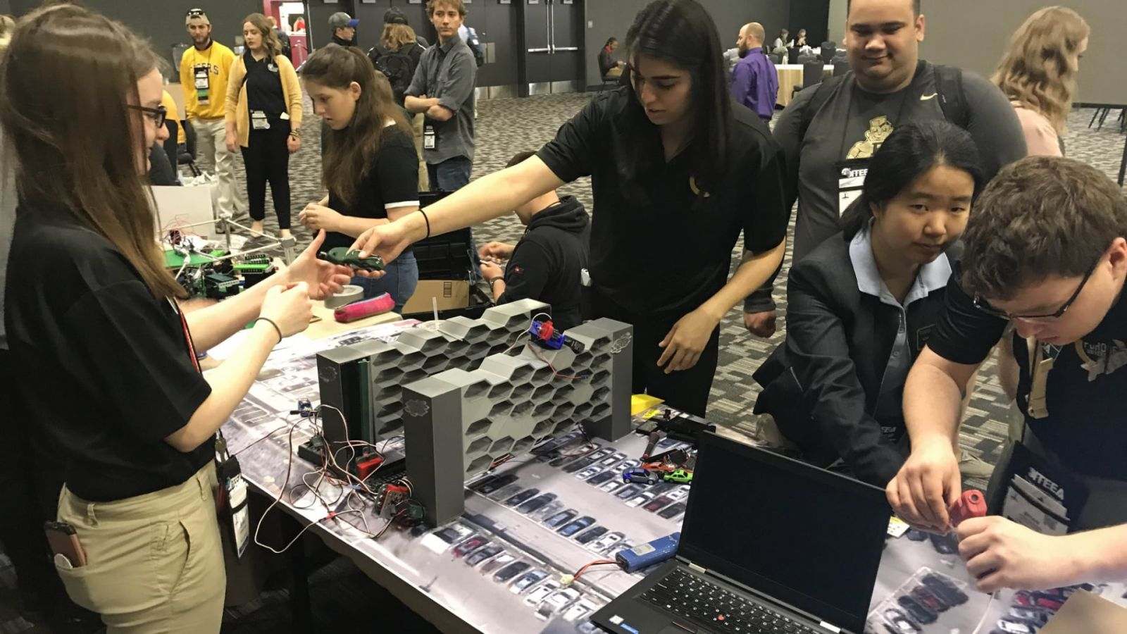Purdue Polytechnic students Daphne Fauber, Vanessa Santana, Zach Laureano, Liwei Zhang and Brian DeRome engage their problem-solving skills at the 2019 ITEEA conference.