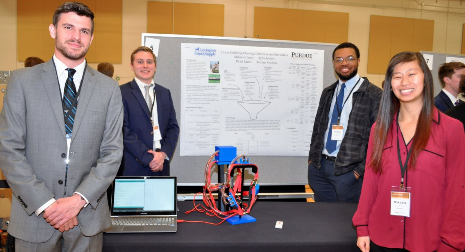 A student team poses with their senior capstone project during the 2018 Purdue Polytechnic Tech Expo