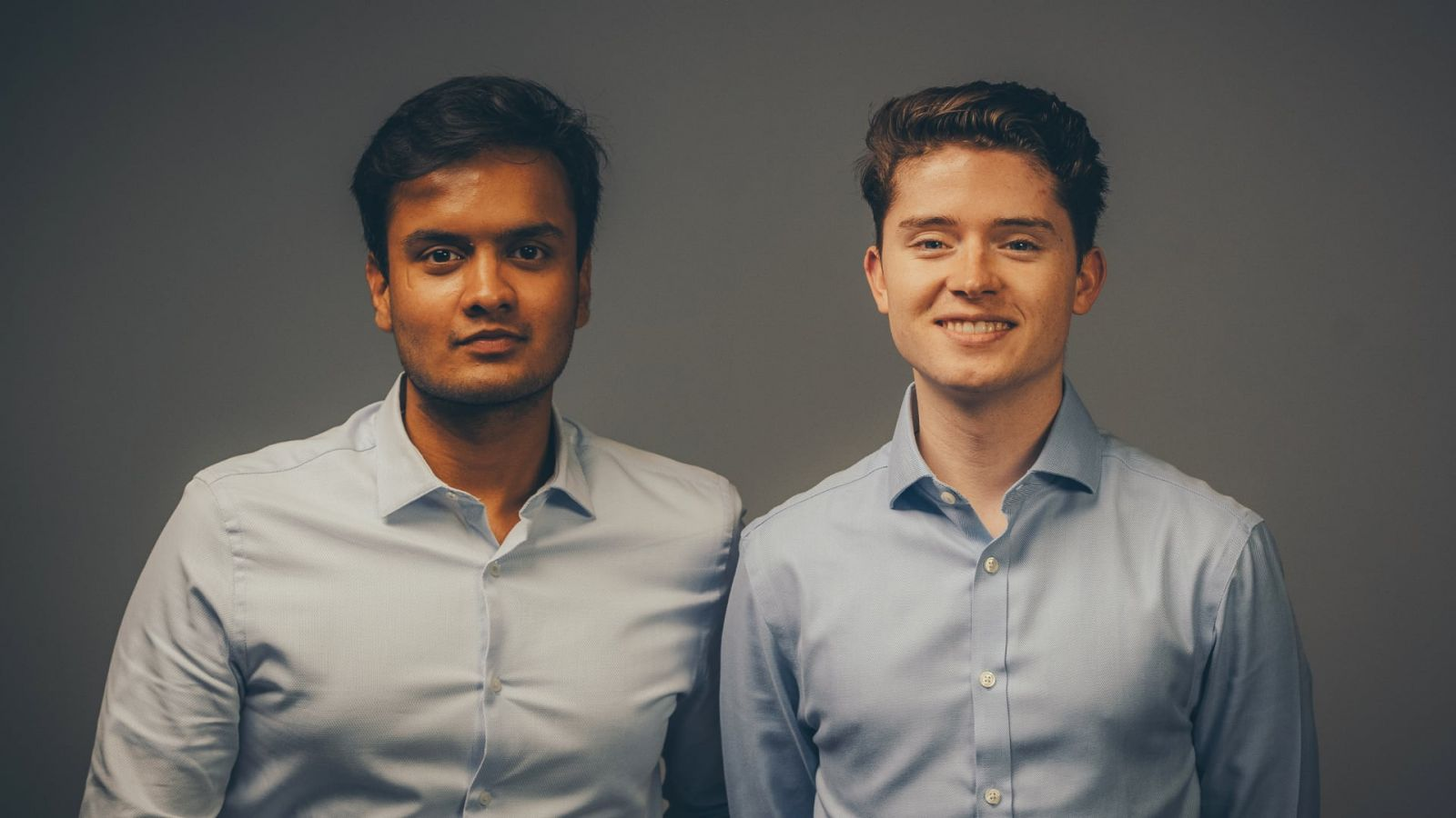 Nishant Jain (left), an electrical engineering technology graduate from the Purdue Polytechnic Institute and Thibault Corens, who earned a double major from the Polytechnic Institute in mechanical engineering technology and manufacturing engineering technology, are co-founders of Presso Inc., a kiosk garment cleaning device that takes only three to seven minutes to clean clothes through a combination of steam, a cleaning liquid and air drying. (Photo provided)