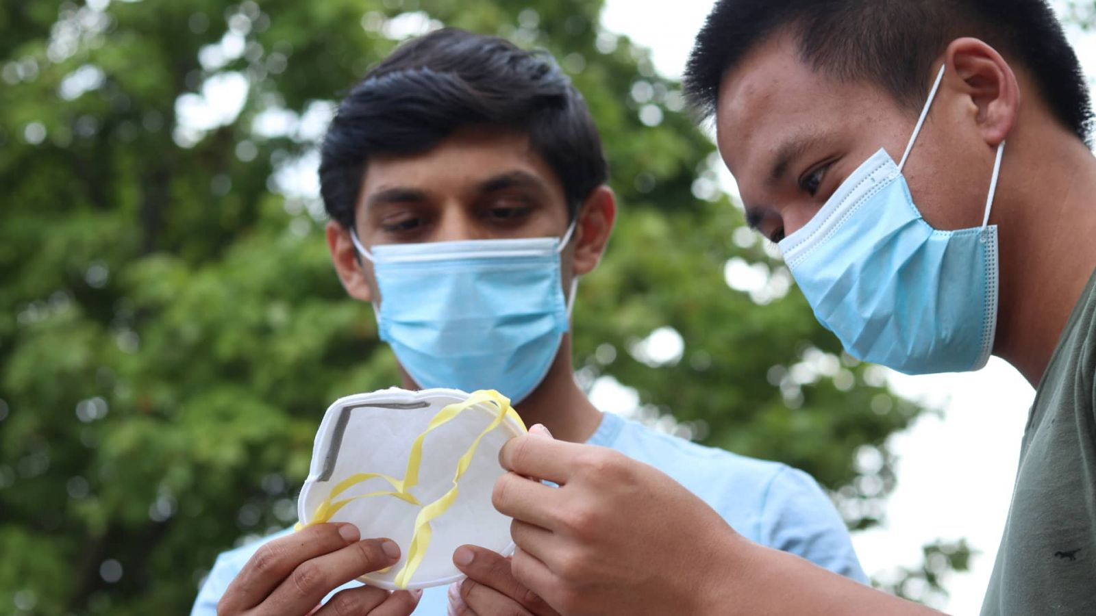 Hersh Rai and Nicholas Toan-Nang Vu discuss design improvements for traditional N95 masks.