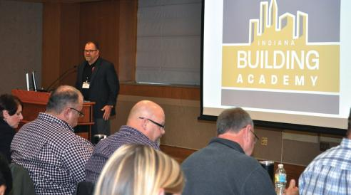 Brad Benhart welcomes attendees to the inaugural Indiana Building Academy