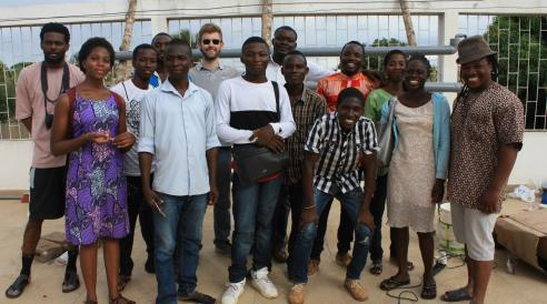 Scott Massey (center, with sunglasses), a founder of Heliponix LLC, poses with residents of Togo