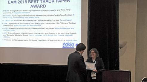 Louis Hickman (left) accepts award at the Eastern Academy of Management Conference